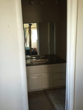 BEFORE: The tiny pocket door from the bedroom into the bathroom.